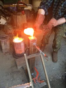 Pouring molten bronze to make a sword
