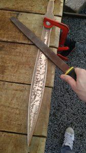 Filing a sword